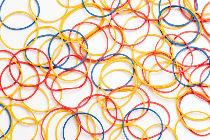 Full frame shot of rubber bands over white background
