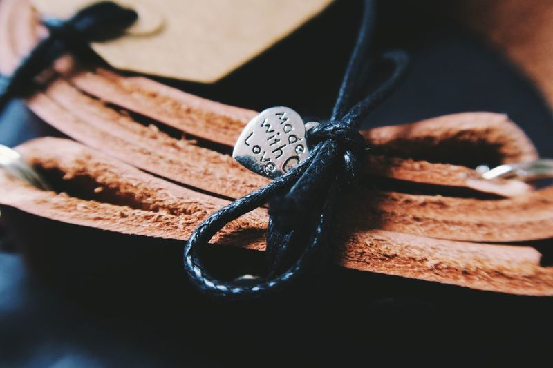 High angle view of heart shape with text on leather strap