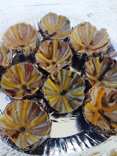 Edible Sea Urchins sold in the middleof the sea.