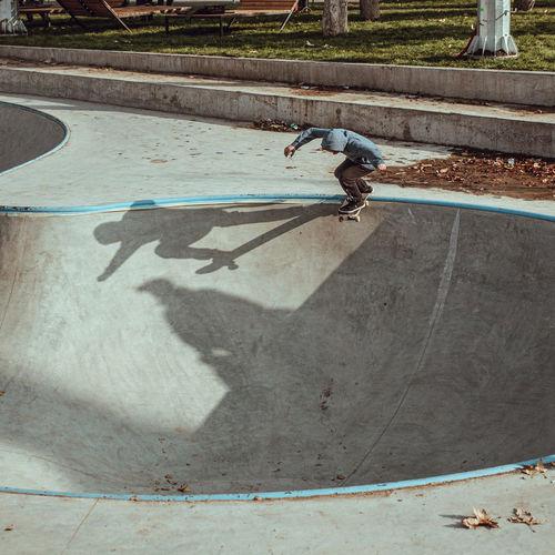 High angle view of man skateboarding on swimming pool