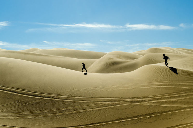 Adult Arid Climate Day Desert Extreme Terrain Full Length Landscape Landscapes Nature Only Men Outdoors People Sand Sand Dune Sky