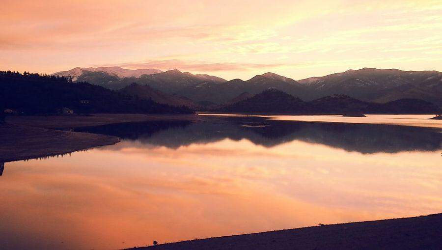 Reflection of mountain range in calm lake