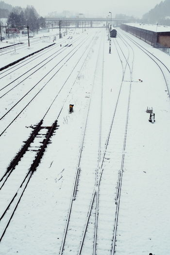 Train tracks covered in snow a cold winters day in Sweden Winter Wintertime Sweden Swedish Winter Snow Railway Railway Tracks Tracks Train Station Train Yard Borås No Release Needed Taken From Above Traffic Transportation Weather Weather Conditions Dark Melancholy Landscape Transport Train