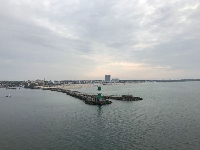 Germany🇩🇪 Warnemünde Lighthouse Ostsee Hotel Neptun Aida IPhone X Photography Baltic Sea IPhone X Sky Water Cloud - Sky Waterfront Sea Architecture Built Structure Nature Building Exterior No People Beauty In Nature Scenics - Nature Tranquility Tranquil Scene Day Guidance Outdoors Building City
