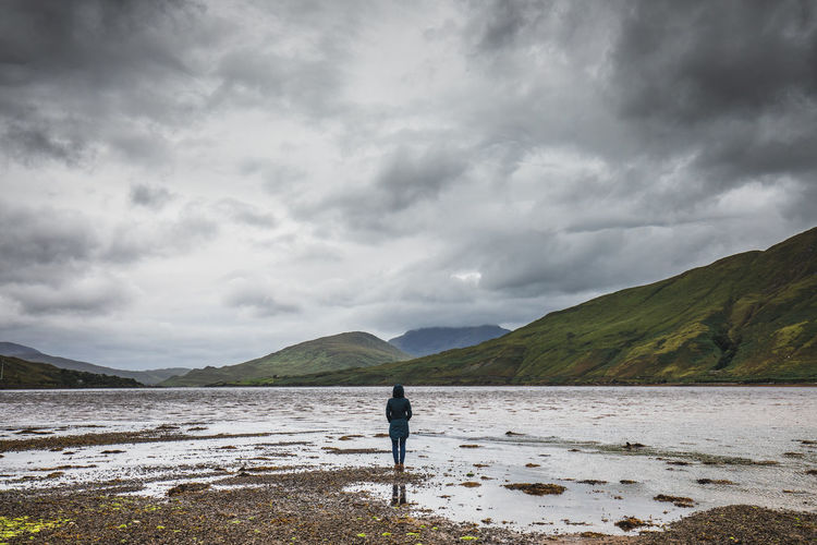 Alone (Leenane, Galway, Ireland Alone Sad Nature Photography Ireland Leenane Fjord Lenaune Galway Antrim Full Length Mountain Standing Sky Landscape Cloud - Sky Lakeside Overcast Tranquil Scene Atmospheric Mood Weather Moody Sky Forked Lightning Remote Storm Cloud Cumulus Tranquility Thunderstorm My Best Travel Photo