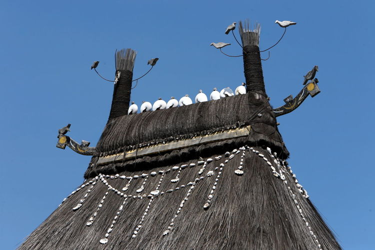 Thatch Roof Hut Crowned With Thatched Bird