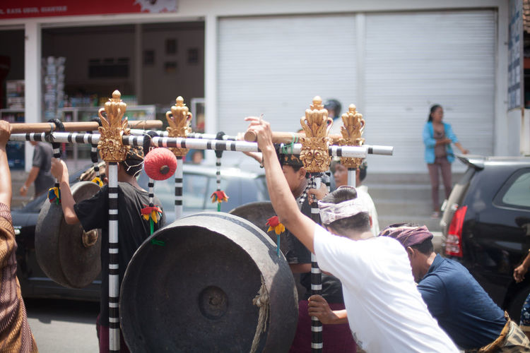 People playing gamelan orchestra on street