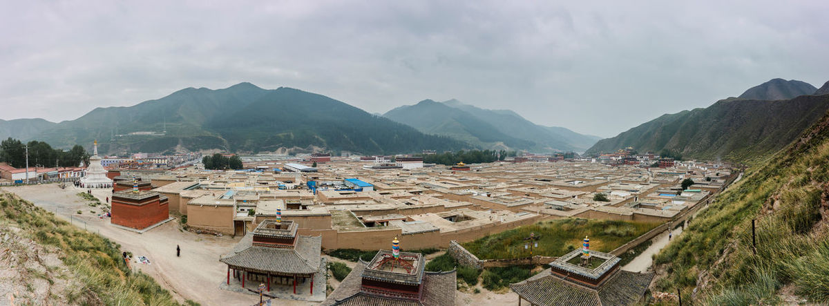 Labrang Temple is a university of Tibetan Buddhism lies in Xiahe, Gannan, China. Here you can see the dormitories and the temples on the far right of this photo. Belief Campus China Dormitory Famous Place Gansu Labrang Mountain Panoramic Religion Temple Tibetan Buddhism Tradition Tranquility Travel University