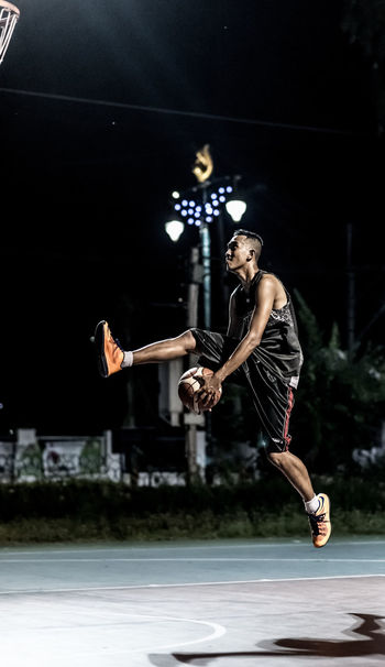 Portrait of Basketball player Action Activity Basketball Basketball Court Basketball Is Life Basketball ❤ Carrying Flying Handel Handheld Jump Jumping Lay Up Man Mid-air Night Sport Performance Play Portrait Shadow Sport Sports Photography Sporty Thailand Young Adult