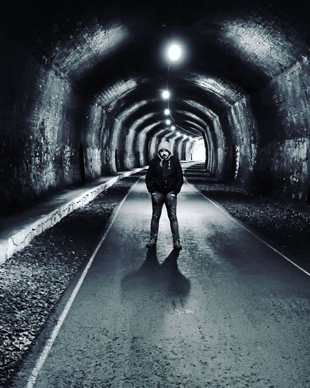 Tunnel One Person Full Length Illuminated Real People Indoors  The Way Forward Adult Lifestyles Standing People Night Adults Only Architecture Only Women One Woman Only