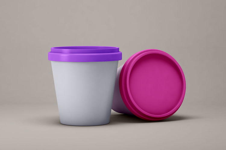Close-up of cup of pink over white background