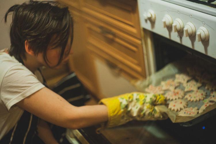 Woman putting cookies in mircrowave