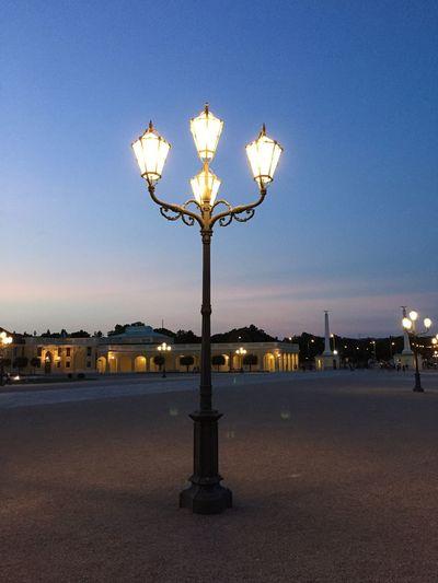 Illuminated street light against clear sky at night