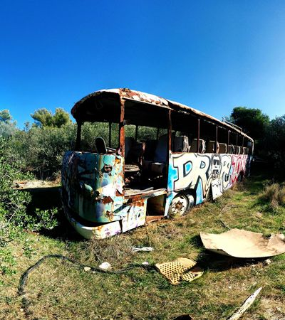 Bus Land Vehicle Transportation Abandoned Clear Sky Outdoors No People Stationary Day Sky Nature Nature Takes Over Penteli Greece Trees And Sky Trees Flat Tyre Abandoned Bus