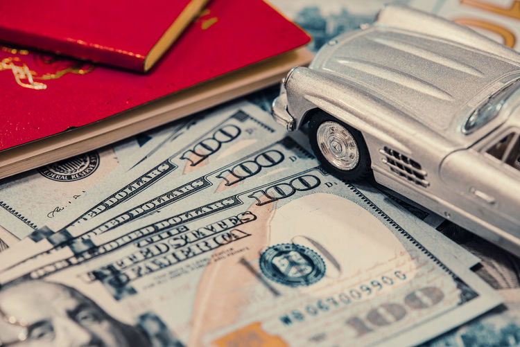 Close-Up Of Toy Car And Paper Currency