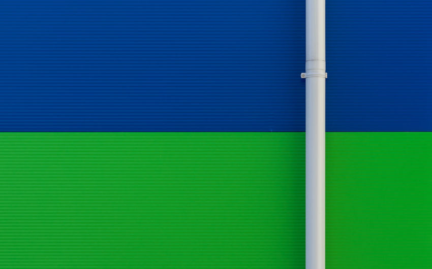 Pipe on green and blue wall