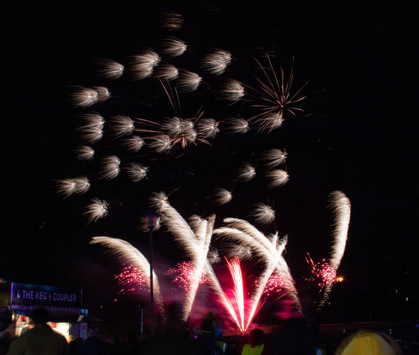 Night Illuminated Firework Multi Colored Firework Display Dark Exploding Firework - Man Made Object Long Exposure