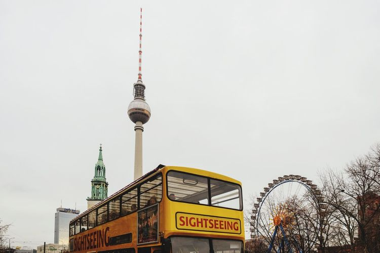 Communication Tower Architecture City Built Structure Outdoors Building Exterior Travel Low Angle View Television Tower Sky No People Travel Destinations Text Day Alexanderplatz Capture Berlin Berlin Germany City Sightseeing Bus