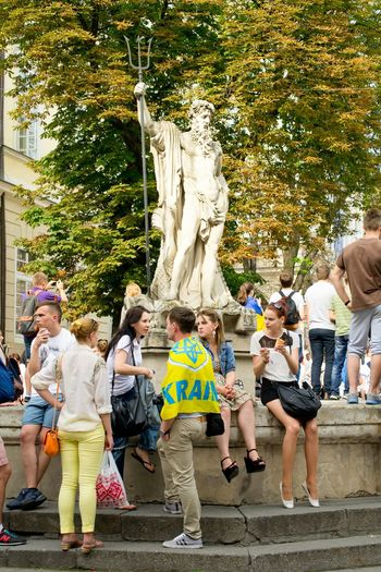 Enjoying Life Young Piople Ukraine L'viv Street Photography Monument Neptune Flag Snapshots Of Life