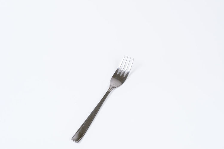 Eating Equipment Food Fork Garpu Kitchen Utensil Utensils White Background Studio Shot Copy Space Kitchen Utensil Eating Utensil Indoors  Single Object Still Life Close-up Household Equipment Cut Out No People Metal Silver Colored Food And Drink Silverware  Plate High Angle View Steel Crockery Clean