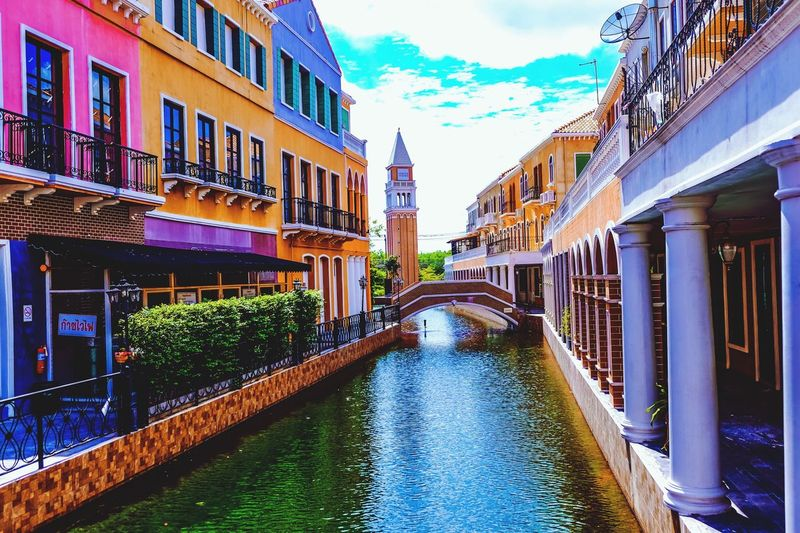 Architecture Building Exterior Canal Built Structure Cloud - Sky Sky Water Travel Destinations Outdoors Day Bridge - Man Made Structure No People Footbridge Multi Colored City Gondola - Traditional Boat Flood Nature Venice Italy Europe Town Canal Landmark Aisia