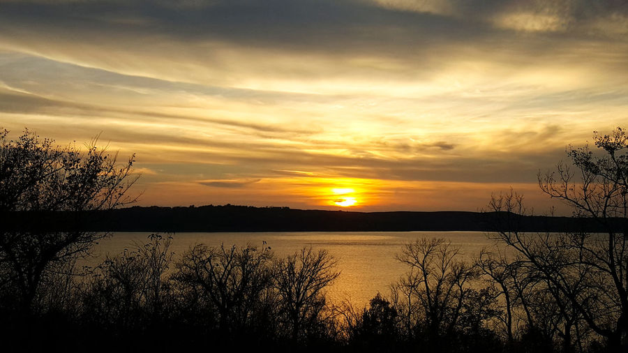 Autumn Sunset Bare Tree Beauty In Nature Cloud - Sky Day Grass Idyllic Lake Landscape Nature No People Outdoors Reflection Scenics Silhouette Sky Sunset Tranquil Scene Tranquility Travel Destinations Tree Tuttle Creek Reservoir Tuttlecreek Water