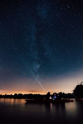 Boat In Lake Against Star Field At Night