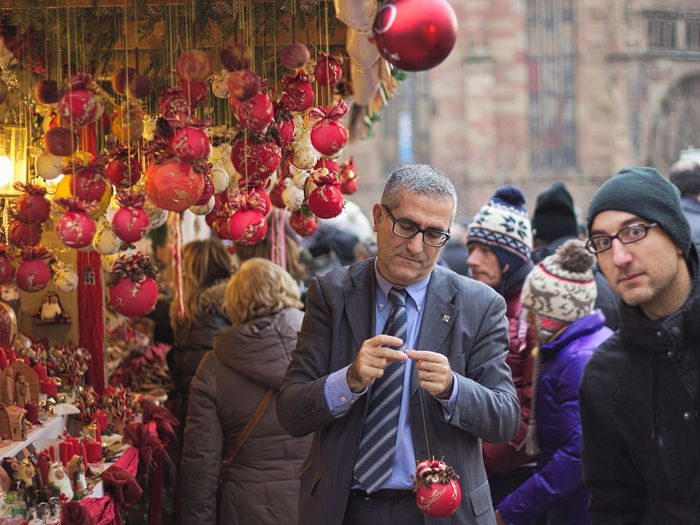 Well turned out...and a curios man Arts Culture And Entertainment At Bolzano | Bozen Berry Cherry Christmas Balls Christmas Decorations Christmas Tree Cultures Day Focus On Foreground Food And Drink Friendship Fruit Fun Hanging Happiness Healthy Eating Holding Real People Red Ripe Selective Focus Twig Vintage Christmas Decorations Well Turned Out