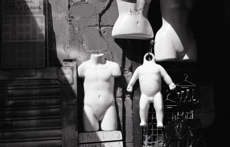 Mannequins against wall