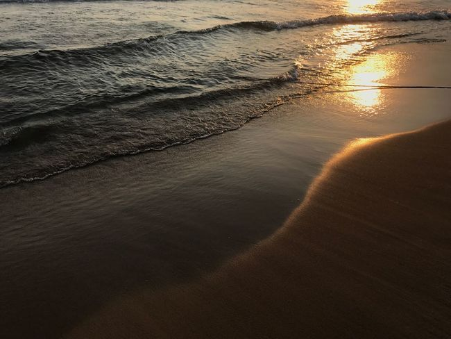 The Beach Sea Sunset Water Nature Scenics Beauty In Nature Beach Sand Tranquility Outdoors No People Wave Sunlight Day Sky Perspectives On Nature