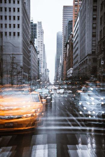 Traffic on city street during rainy season