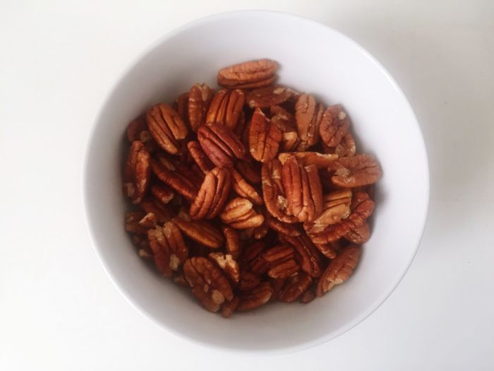 Nutrition Food And Drink Food Bowl Healthy Eating Still Life White Background Freshness No People Directly Above Ready-to-eat Plate Table Indoors  Close-up Studio Shot Day Pecan Nuts Diabetes