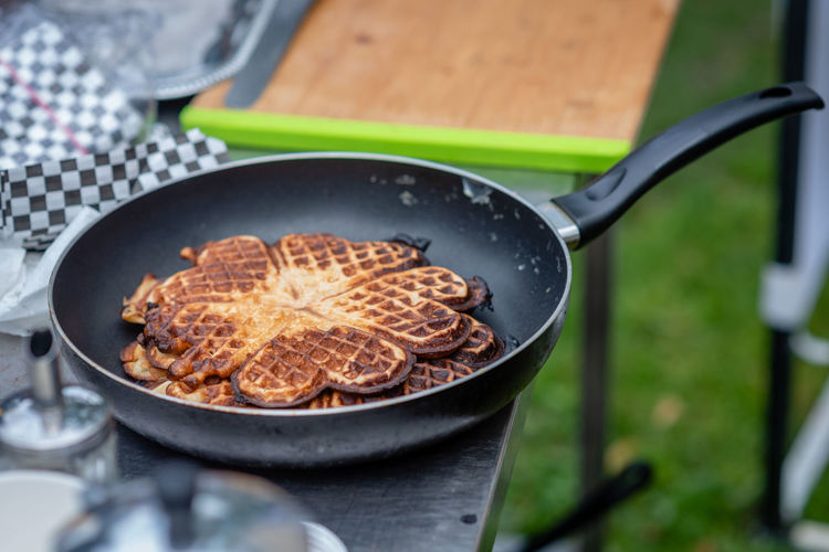 Pancakes in a frying pan outdoor picnic. Cooking Crêpes Dessert Homemade Picnic Snack Baked Barbecue Close-up Cooking Pan Delicious Eat Eating Utensil Food Food And Drink Freshness Fried Fruit Frying Pan Gourment Griddle Healthy Eating High Angle View Household Equipment Indoors  Kitchen Utensil No People Nutrition Outdoor Pan Pancake Preparation  Ready-to-eat Selective Focus Snack Spoon Street Tasty