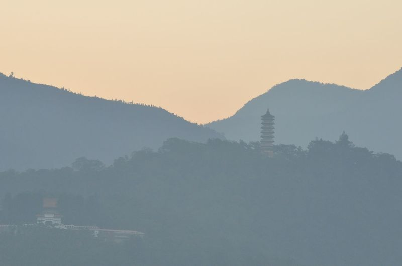 Scenic view of mountains against sky at morning