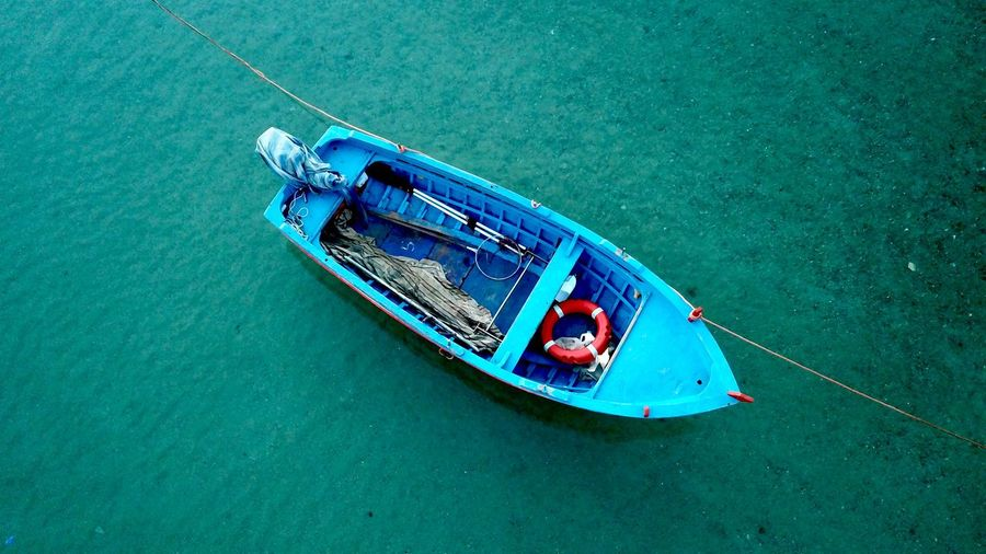 High angle view of boat moored on sea