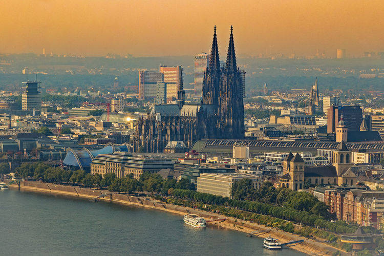 so hoch wie der Dom Cologne , Köln,  Morning Light Architecture Bridge Building Building Exterior Built Structure Chathedral City Cityscape No People Outdoors River Sky Tower To Tower