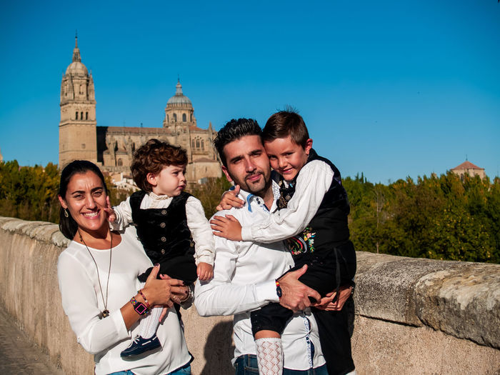 Family Child Childhood Children Real People Lifestyles Travel Salamanca Travel Destinations Tourism Tourist Destination Catedral De Salamanca Cathedral City Urban Traveler Enjoying Life Leisure Brother Traditional Clothing Spanish Culture SPAIN Love Smiling Group Of People Togetherness Architecture Young Adult Men Emotion Young Men Bonding Sky Built Structure Women Young Women Adult Happiness Three Quarter Length Building Exterior Outdoors