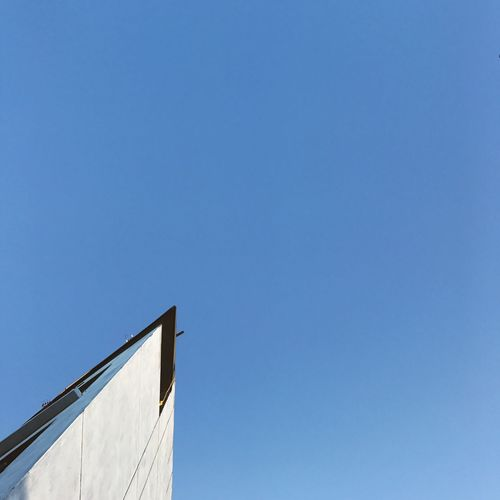 Low angle view of built structure against blue sky