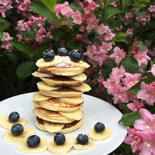 Stack of pancakes with banana and blueberry