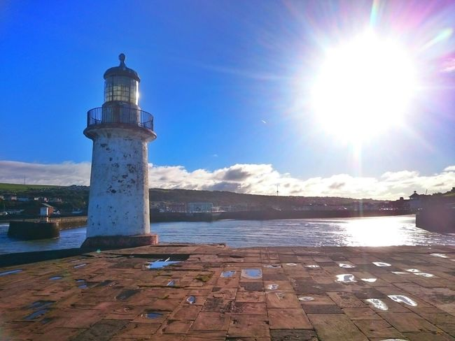 Sunlight Sky Water Lighthouse Outdoors Vertical Test Of Time Whitehaven Habour Lighthouse, Beacon, Light, Guide, Tower, Warn, Harbour View Harbour Front Walking Around Out And About Architecture Cloud And Sky Seascape Horizon Over Water Coastline Tranquility Sunlight Cloud - Sky Waterfront