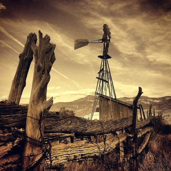 Skies of Lund Sky No People Outdoors Day Nevada Mountains Travel Destinations Ghosttowns Nostalgic Photo Old Wood Old West  Broken Travel Nevada Travel Photography President Trump Promised Land Nevada Wagon Wheel Southwestern Crossroad Aeromotor Windmill