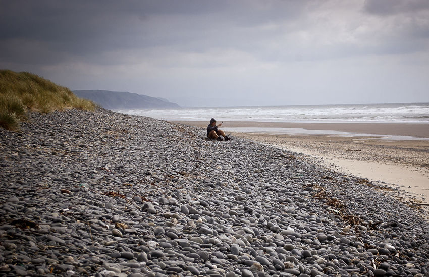 Tranquility Animal Themes Beach Beauty In Nature Borth, Wales Day Nature One Person Outdoors People Scenics Sea Sky Tranquil Scene Tranquility Water