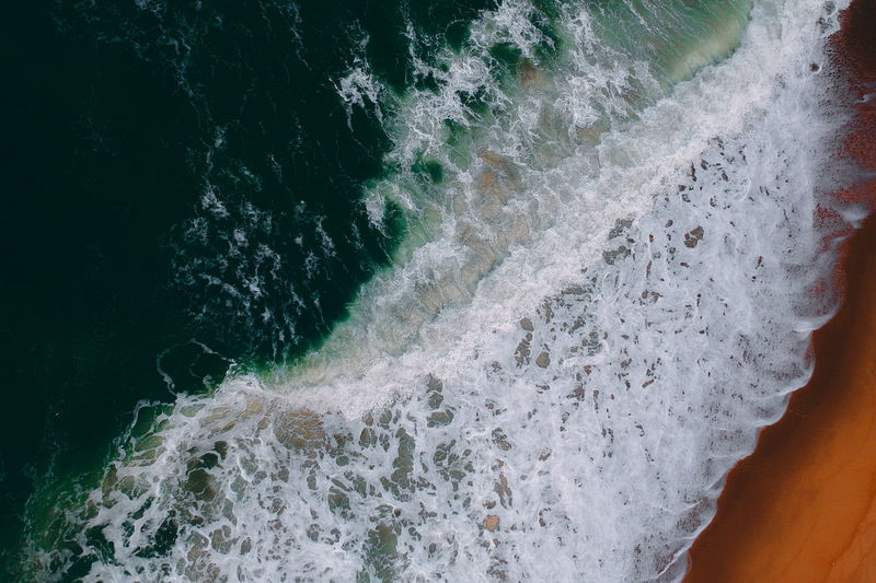 aerial view of sea waves water texture background Motion Water Sea Sport Aquatic Sport Wave Beauty In Nature Surfing Nature Scenics - Nature Day Blurred Motion Power In Nature Outdoors Splashing Power Land Close-up Flowing Water Flowing Breaking