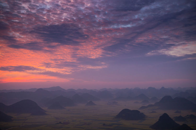 Sky Beauty In Nature Scenics - Nature Tranquil Scene Cloud - Sky Tranquility Sunset Non-urban Scene Idyllic Mountain Landscape Nature No People Environment Mountain Range Rock Outdoors Remote Rock - Object Arid Climate