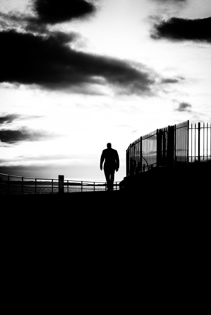 silhouette, railing, one person, sky, cloud - sky, outdoors, standing, full length, men, real people, day, sea, one man only, nature, people