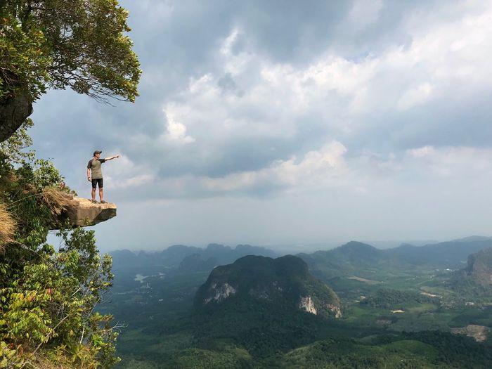 Full Length On Man Standing On Cliff Against Landscape