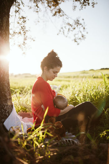 Breastfeeding Baby Mother Mother & Daughter Mother And Son Nursing Sunset_collection Tranquility Babyfeeding Child Field Grass Growth Land Lens Flare Mommy Mommy & Baby Time <3 Mothernature Nature Nursinglife Peaceful Sunset Tranquil Scene Tranquillity This Is Family