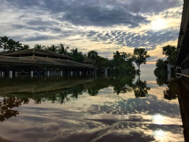 Reflection Water Sky Cloud - Sky Architecture Built Structure Lake Waterfront Nature Outdoors No People Sunset Tree Building Exterior Day Beauty In Nature