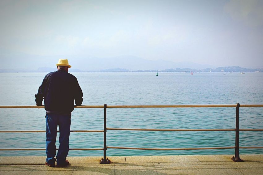 Sea Water Rear View Standing One Person Full Length Railing Men Sky Beauty In Nature Nature Horizon Over Water Tranquil Scene