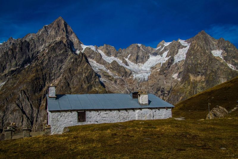 mallatra,val ferret,courmayeur,italy Mountain Mountain Range Landscape Scenics - Nature Environment No People Nature Sky Blue Architecture Day Built Structure Solid Travel Destinations Grass Travel Land Outdoors Beauty In Nature Non-urban Scene Mountain Peak